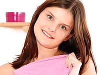 Schoolgirl strips and masturbates