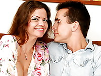 June has recently gotten married and is beginning a new life. She's got a new man, a new house, great money, and a huge problem. She's realizing that she has forbidden feelings for her new stepson. And her stepson can't help but notice the hot body on his new stepmom. They don't want to break up the family, but they can't deny their lust for one another. One day as they were home alone together, June invites her stepson to sit down with her on the couch and things start to get out of hand. The two of them begin to make out and then she goes down on his younger cock. They bang on the couch in a forbidden romance that they can't control.