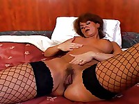 Mature Whore In Fishnets Takes Black Rod