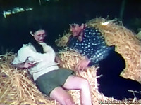 A couple is laying in the haystack in a barn. The guy is touching the girl up, licking her tits. Then she gives him a blow job until the farmer and his wife come in. At first they are angry but they end up in a foursome.