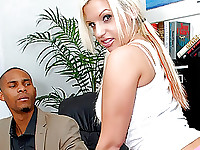 At the office a guy is sitting at his desk and in comes Whitney a very hot blond chick with tiny pink shots on and a white tee and sneakers.  She just poses a little then starts talking to the guy. Pretty soon she's on her knees and his long hard cock is out of his pants in front of her sexy face. It doesn't take her long to get his long hard cock in her mouth and start sucking on it as he's grabbing her hair. She then stops and he pulls down her short pink shorts to inspect her ass, and then the shirt, bra, and panties follow. She starts sucking his cock again before he sits in the chair and she starts eagerly riding his long hard dick.