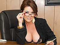 Raquel Devine is a hardworking businesswoman who is in the mood for some fun, so she calls in one of her underlings and decides to find out for herself whether he has a big dick or not. She ends up working her tongue up and down Chris Johnson's dick, loving the way it feels against her mouth. She is great at giving a blowjob, although she is also rather adept at making sure that this guy is going to cum all over her when he's done. She's going to have a hell of a time cleaning up the mess in her office.