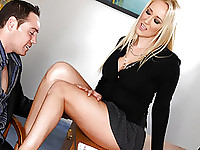 Stacked blond Alana Evans looks completely sensational in her slutty office outfit.  She leans over the desk, facing stud Romeo Price, who gets an amazing view of her impressive cleavage.  Her skirt rides up at the back, showing off her ass then Alana sits in front of the stud on the desk, showing off her panties, which are sheer against her bald pussy.  Romeo licks his lips as he pulls those panties to one side and starts tonguing Alana's pussy, making her moan as he stimulates her clit and even licks her ass hole as well.  Soon Alana is bent over the desk, gripping onto it on for dear life as Romeo slams her good from the back.