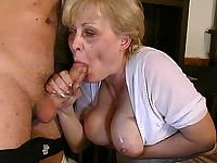 Busty granny in blowjob