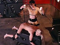 Tied up blonde gets hot wax on her back