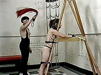 Bossy lesbian ties and spanks her slave