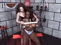 An ebony babe gets her huge tits tied up and then squeezed in a vice with clothespins