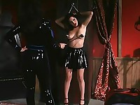 A girl is chained and titty whipped