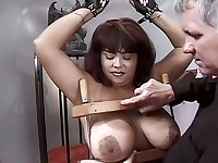 A man gags and hog-ties his girlslave