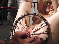 A master squeezes slave's tits with pegs