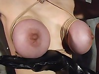 A pin wheel stings a busty babe's teats