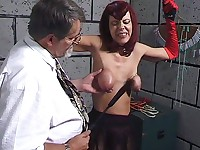 A professor slaps his slave girl's tits