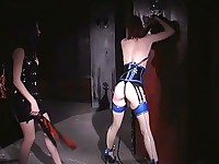 Redheaded girl is flogged on her ass