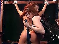 Redheaded lady smacks her female slave