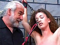 Shackled up slave has her body lashed