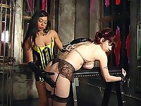 A slave gets her boobs tied violently
