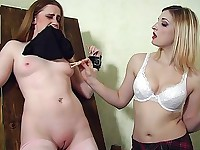 A cute slave asks her mistress not to squeeze her bared teats with these clothes pegs