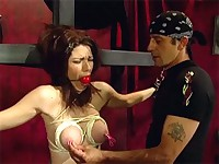Slave has her boobs tied up and clamped