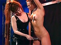 Slave is clamped, flogged and tortured with a vibrator and with a strap-on by her mistress