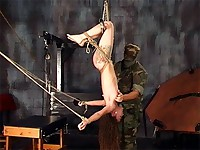 Slave is tied and hung upside down