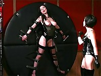 Slave's pussy lips clamped extra tight