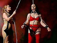 A slut plays with her chained mate