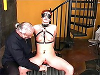 Tight clamps are attached to a rope and pulled on by her master to inflict more punishment