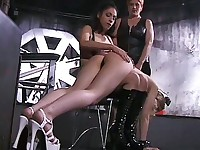 Two cruel women punishing their slave