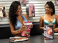 Curvy ebony lesbian girls raiding a sex-shop to find some more ways to make each other cum