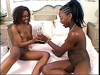 Two horny black whores lick each other