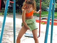 Fair-hair gal in orange and green has pissing fun on the jinky board