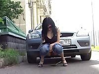 Peeing near a car