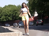 Public pisser wears a skirt on top of her pee-drenched yellow shorts