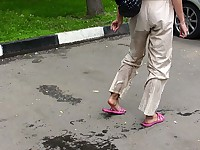 Amateur piss addict wets herself and leaves wet traces on the asphalt