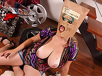 Busty bag head Sima drops to her knees and pull out our camera mans big cock to gobble down her throat then pump between her giant udder until he sprays a big load into her open waiting mouth and over the bag