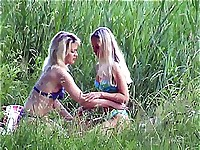 Two lesbian blondes make out near a lake getting caught on a camera