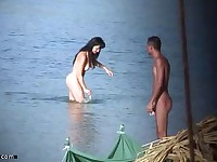 Naked brunette captured on hidden beach cam by a devoted nudity fan