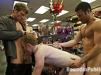 Hot Gym Trainer Gets Tied up and Gang Fucked in a Porn Store
