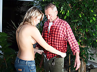 An elderly man is busy gardening but is bothered by his back. By coincidence a blonde girl rings the bell, offering help. She is not very good with the watering can, soaking the fellows clothes all over. She lets him undress and when he is naked she gives him a thorough blow job before both of them fuck in the greenhouse.