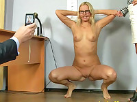 Looks like these HR perverts are sure their office is a local gym - or else why this totally undressed secretary has to strike the kinky sports poses for their camera? And why the hell must she squat with a cane, squeezed with her teeth (still posing for the maledom interview cam and being verbally humiliated by the lesbian clerk)? No problem, babe, you can leave this room and let the other candidate get this job!