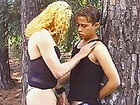 Sexy blonde tranny sucks boner licks ass hole and has her cock sucked in forest.