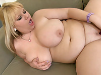 Chubby blonde plays with rubber toy