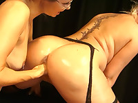 Oiled babe pussy fisted