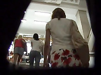 Babe put on her best top and her best flowered skirt and went on shopping and I took my best camera and went on my hunting during which I recorded this shopping chick's nice upskirt!